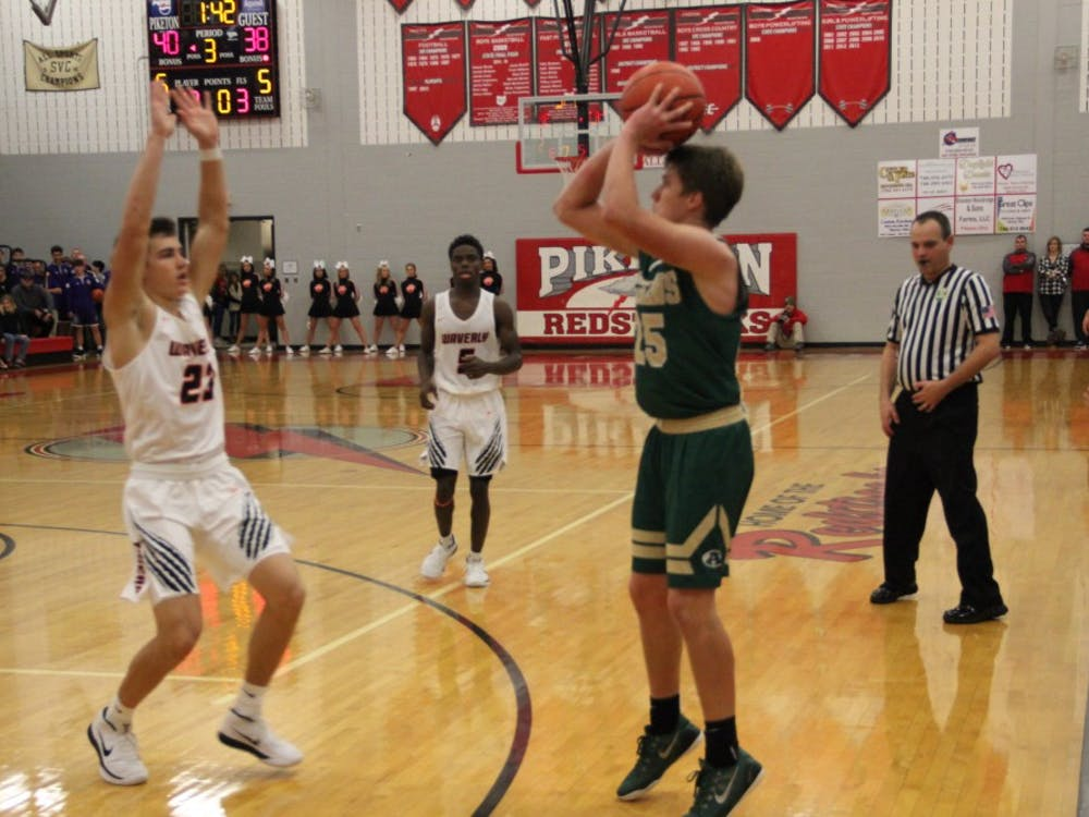 Logan Maxfield takes a three-pointer in the 60-54 loss to Waverly for Athens in which Maxfield scored 14 points.