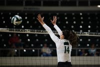 Ohio's Jaime Kosiorek moves to block the ball from crossing the net during the match against Kent State on Sept. 20.