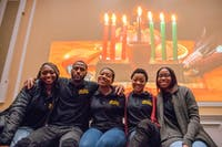 Members of the Black Student Cultural Programming Board (From left to right) Tatiana Farmer, Tyrell Carter, Shelbie Briggs, Janetta Edwards, and Antwanette Pack pose for a portrait at this year's Kwanzaa celebration in the Baker Center ballroom on December 4, 2019.