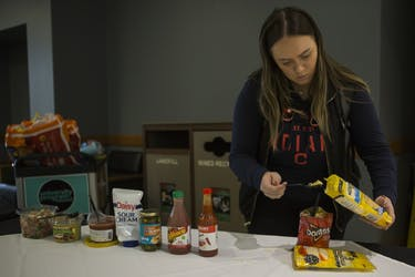 Mackenzie Pippin prepares a walking taco for herself during the weekly Flavor of the Week event on Wednesday, April 25, 2018. Flavor of the Week is a free meal with varying themes provided every Wednesday by the University Program Council.