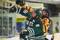 Cody Black (#18) blocks the puck during Ohio's game against West Virginia at the Morgantown Ice Rink. The Bobcats defeated the Mountaineers 11-1. (FILE)