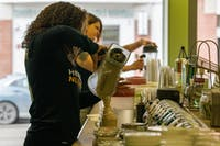 Gabby Morgan pours a shake at Odyssey Nutrition in Athens, Ohio, on Thursday.