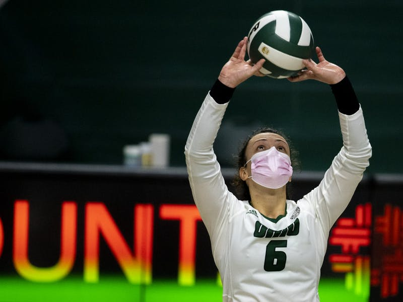 Ohio University setter, Vera Giacomazzi (6), sets the ball to middle hitter, Tia Jimerson, during the home game against Central Michigan University on Saturday, Jan. 23, 2021, in Athens, Ohio. The game was postponed on Friday due to a power outage and resumed on Saturday.