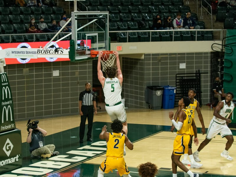 Ohio University's Ben Vander Plas (5) dunks over Kent State players during the home game on Saturday, Jan. 16, 2021, in Athens, Ohio.