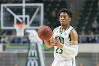 Ohio Univerity's Miles Brown looks for a pass aginst Central Michigan. They won the game 77-69 in the Convo on Tuesday, Feb, 18th, 2020.