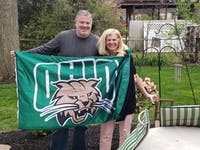 Scott and Cathy Bennett hold an OU flag while reminiscing on their time in school. Photo provided by Scott and Cathy Bennett.