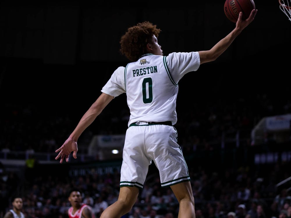Ohio gaurd Jason Preston (0) goes up for a layup in the first half of the Bobcat home victory. The Bobcats ended up scorig 77 points, to beat out Miami's 46 points on Saturday Feb. 8, 2020.