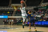 Ohio's Erica Johnson shoots the ball over Toledo's Soleil Barnes during the Bobcats' match in The Convo on Wednesday, Feb. 19, 2020.