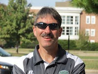 Assistant men's cross country coach Mitch Bentley poses outside of Peden Stadium during Tuesday's practice on October 25, 2016. Coach Bentley was a cross country and track runner at Ohio University who won six All-MAC honors during collegiate career from 1981-1985.