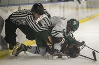 Ohio forward Ryan Higgins (No. 9) fights Calvin defenseman Austin Huizenga (No. 5) during the game on Saturday, Jan.18, 2020, at Bird Arena.
