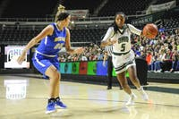 Ohio freshman forward Alexis Stover (#5) drives to the basket in the first half of the Bobcats' 93-37 win over Notre Dame College on November 16.