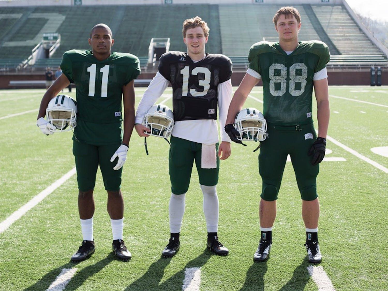 From left to right, freshman wide receiver Willie Cherry, freshman quarterback Deeb Haber, and freshman tight end Ryan Luehrman pose for a portrait at Peden Stadium on April 12, 2017. (EMILY MATTHEWS   PHOTO EDITOR)