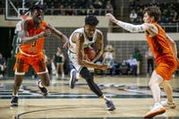 Ohio's Teyvion Kirk (#4) attempts to drive past Bowling Green's Caleb Fields (#3) and Dylan Frye (#5) during the first half of the Bobcats' game against the Falcons' on Friday, Feb. 22, 2019. The Bobcats won 92-87. (FILE)