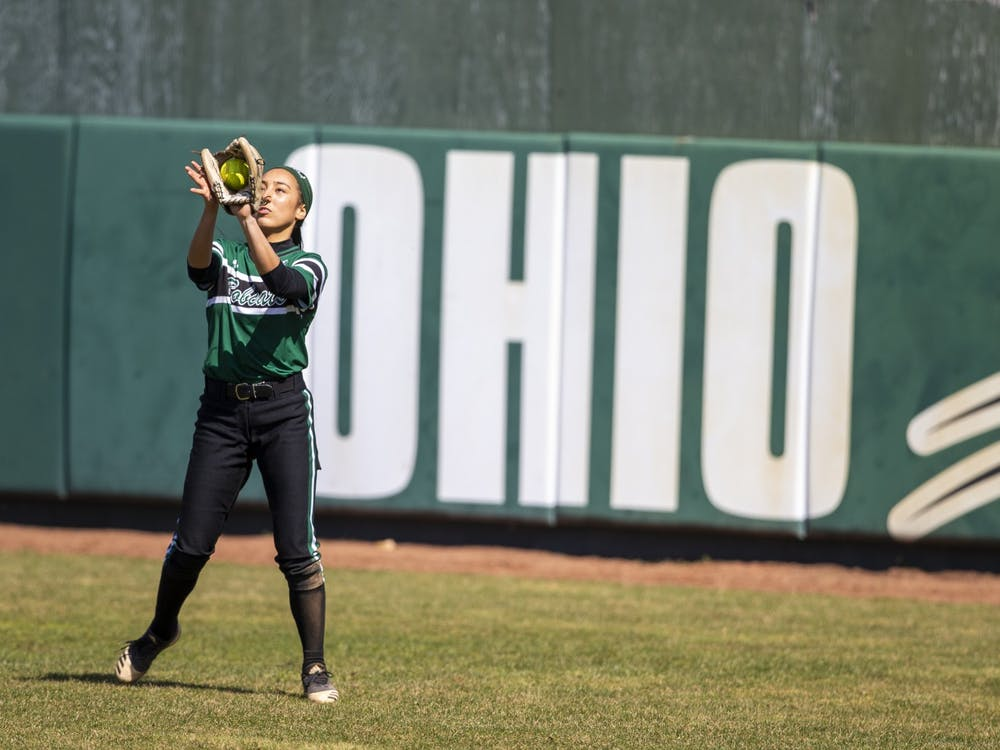 Senior outfielder, Allie Englant (4), catches a pop up during the home game against Northern Illinois University on Saturday, March 20 2021 in Athens, Ohio.