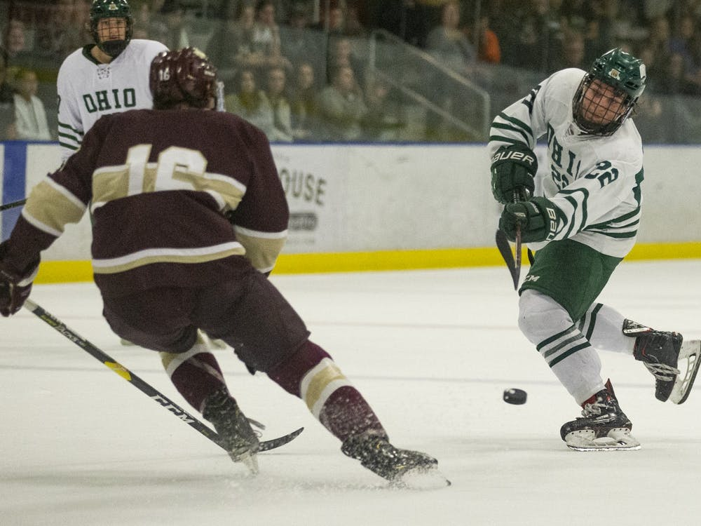 Ohio forward Tyler Harkins (22) fires a puck on net during the first period of the Bobcats game against Robert-Morris Illinois on Friday, October 11, 2019, at Bird Arena in Athens, Ohio. The Bobcats won 4-3 in a shootout. (FILE)