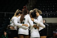 Ohio huddles up before its first match against Samford at the Convo Center.