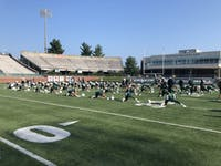 The Bobcats stretch prior to day one of fall camp on Aug. 2, 2019.