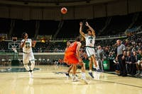 Ohio guard Jason Preston (#0) passes the ball during the game against Campbell on Nov. 12.