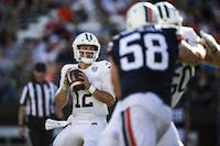 Quarterback Nathan Rourke looks for a pass during Ohio's game against Virginia on September 15, 2018. (FILE)