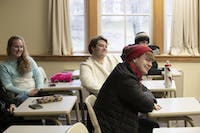 Brock Orr of the Nordic Club at Ohio University laughs while watching a video about Nordic culture.