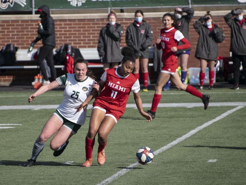 Izzi Boyd (#25) battles for possession of the ball during the Ohio University home game at Peden Stadium in Athens, Ohio, on March 4, 2021. The Bobcats lost to the Redhawks 0-1.