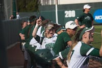 Taylor Saxton and the Ohio dugout cheer during the Bobcats' game against Akron on April 13. (FILE)