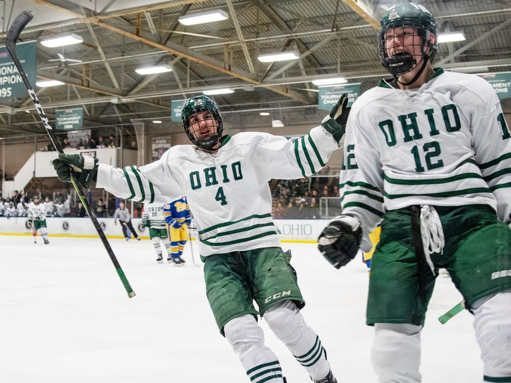 Thomas Pokorney (#4) and J.T. Schimizzi (#12) celebrate a goalduring the Bobcats' game against Pitt on Friday, Feb. 21, 2020, in Bird Arena.