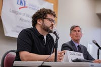 Damon Krane (I) discusses Mayor Patterson's campaign donations from landlords and elite businesses in a mayoral debate held at Athens Public Library on Tuesday, Sept. 23, 2019.
