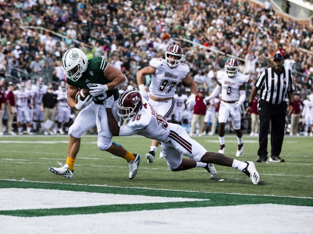 A.J. Ouellette powers his way to a touchdown while playing against UMass. Ouellette would have an impressive day with two touchdowns, as the Bobcats defeated the Minutemen 58-24. (FILE)
