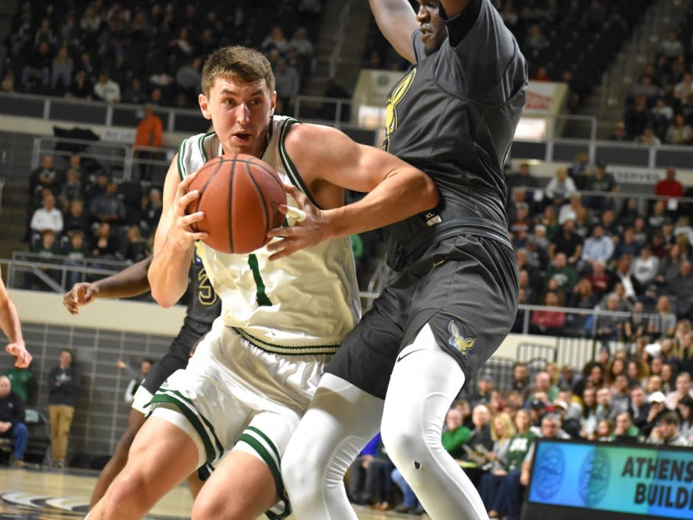 Ohio's Jason Carter (#1) pushes toward the basket during the Bobcats' game against Akron on Saturday, Feb. 2.