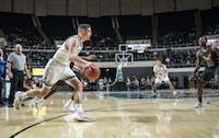 Ben Vander Plas (#5) drives towards the basket during a game against Akron on Feb. 2.