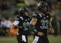 Ohio's Devin King (No. 33), and DL Knock (No. 19), run off the field during the game against Western Michigan on Tuesday, Nov. 12, 2019.