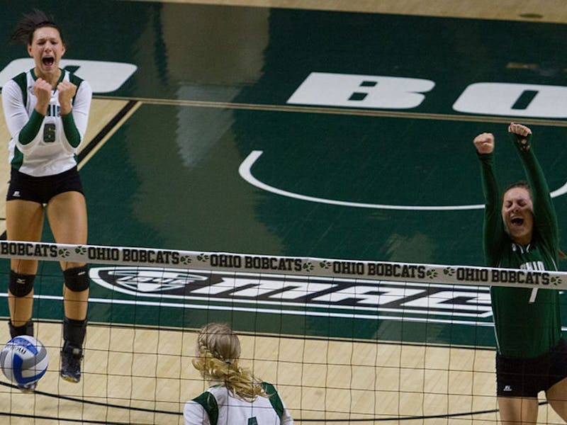 Ohio celebrates a point after a long volley against Eastern Michigan, which the Bobcats won 3-1.