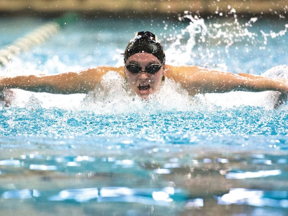 Elena Patz swims in the 200-yard butterfly during the Bobcats' meet with Ball State at the Ohio University Aquatic Center on Jan. 30. (FILE)