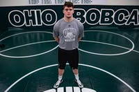 Jordan Earnest poses in the wrestling room in the Convocation Center.