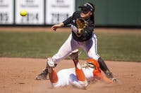 Ohio infielder Charlee Pond (#19) attempts to tag Alex Sorgi (#1) of Bowling Green during the Bobcats game against Bowling Green on Friday, March 23, 2019, in Athens, Ohio. The Bobcats won the second game of the series against the Flacons 8-7 in extra innings.