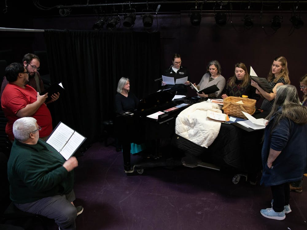 Members of SATB choir rehearse on Tuesday, Jan. 21, 2020 at Arts West to prepare for an upcoming concert that benefits PRISM.