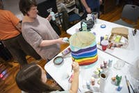Jordan Black and Laura Nudeau painting a lamp shade at The Gathering Place 's house on March 2, 2020. They are preparing for their Annual Advocacy Event on March 5, 2020 in Athens, Ohio.