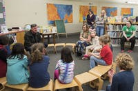 Mayor Steve Patterson reads a book to children at the Athens Public library. The library teamed up with the Ohio University Student Senate to have story time and craft night for Pride Week on Tuesday, March 27.