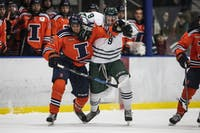 Ohio forward Austin Heakins (#9) gets tangled up with an Illinois defenseman during the Bobcats' game against Illinois on Friday, Dec. 7, 2018 where they lost 4-0.
