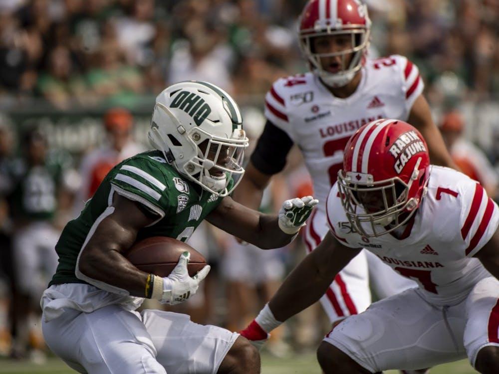 Ohio University wide receiver, Jerome Buckner (#8), runs the ball against University of Louisiana linebacker, Ferrod Gardner (#7) during the bobcat's home game on Saturday, Sept. 21, 2019.