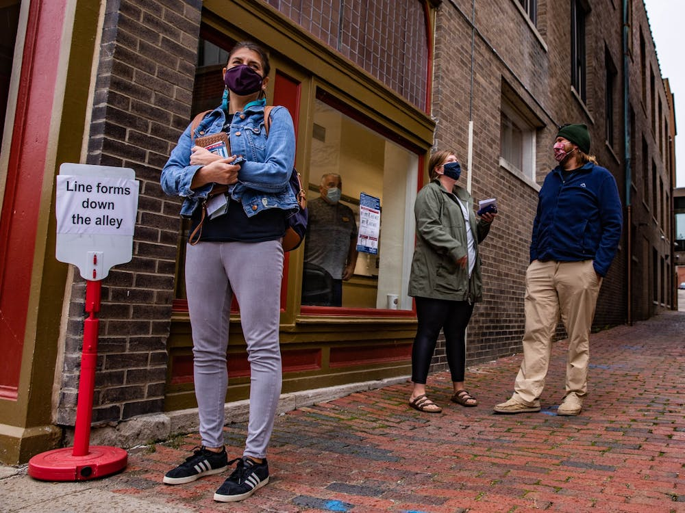 (Left to right) Jennifer Trainer, Sara Andrews and David Rothwell wait in line outside the Athens County Board of Elections office, anticipating their opportunity to vote early on Tuesday, Oct. 27, 2020, with only a week left until polling locations close for the general election.