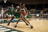 Teyvion Kirk, of Ohio, defends the ball against James Thompson IV, of Eastern Michigan,  during the Ohio versus Eastern Michigan game on Tuesday, Februrary 12, 2019.