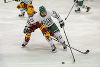 Ohio forward Matt Rudin (#27) battles with Iowa State forward Tony Uglem (#7) during the first period of the Bobcats' game against Iowa State on Saturday, Feb. 16.