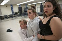 Taylor Mayne (left) Kenna McWilliams, center, and Lena Daitz (right) rehearse for a performance of Le Comte Ory by Gioachino Rossini in Athens, Ohio, on Monday, Nov. 5, 2019.