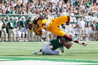 CMU's Tyler Conklin (top) is taken down by OU's Kylan Nelson as Conklin attempts a touchdown during the 2017 homecoming game on October 7.  (MIJANA MAZUR   FOR THE POST)