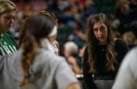 Steph Haas addresses players during a team huddle of Ohio's game against Purdue on Dec. 5 at The Convo.