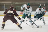 Ohio University's Thomas Pokorney attempts to pass the puck past Robert Morris University's Anthony Podder during the game on Saturday, October 12, 2019, at Bird Arena. Ohio won the match 3-0. (FILE)