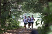 Ohio's Jake Gentile, Andrew Miller and Kurt Steinmuller run together early in a race September 2014. (File)(Correction: A previous version of this photo caption incorrectly stated the date. The race took place in September 2014. The caption has been updated.)
