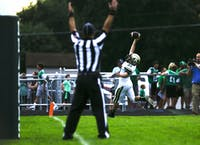 Athens running back Evan Adams celebrates a touchdown during a game against Fairland on Friday, Aug. 31, 2018. Athens went on to lose the game 35-31.